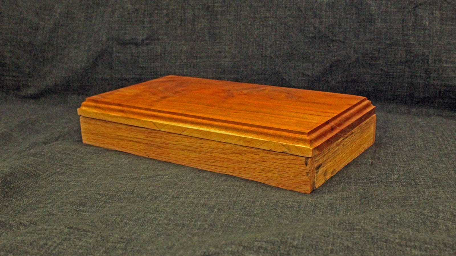 A cherry and red oak box, with a roman OG profile.