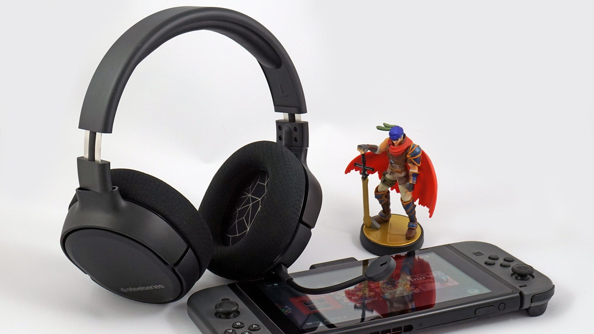 The Arctis 1 Wireless Headset sitting next to a Nintendo Switch.