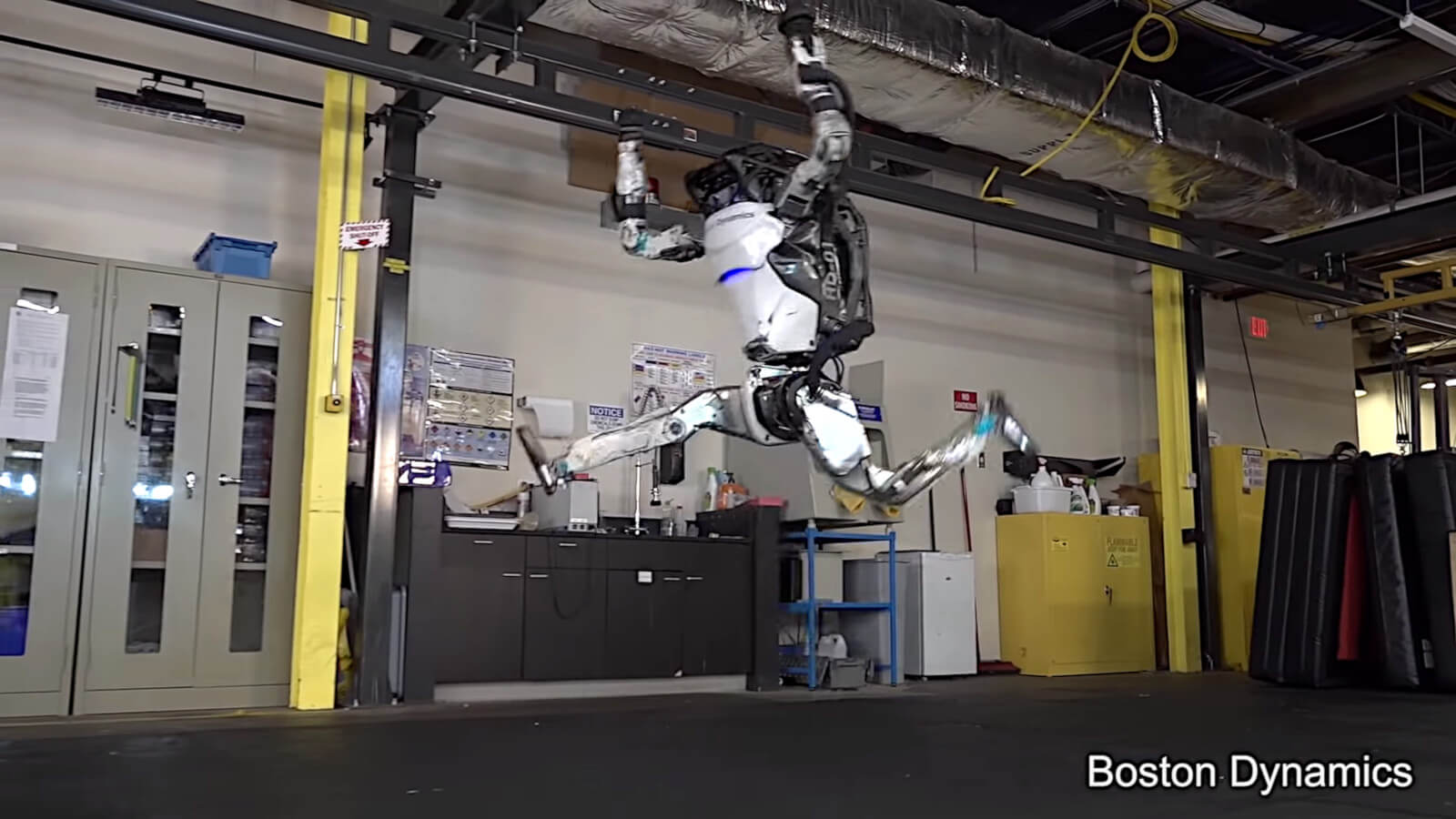 Boston Dynamics Atlas robot does a split in the air.