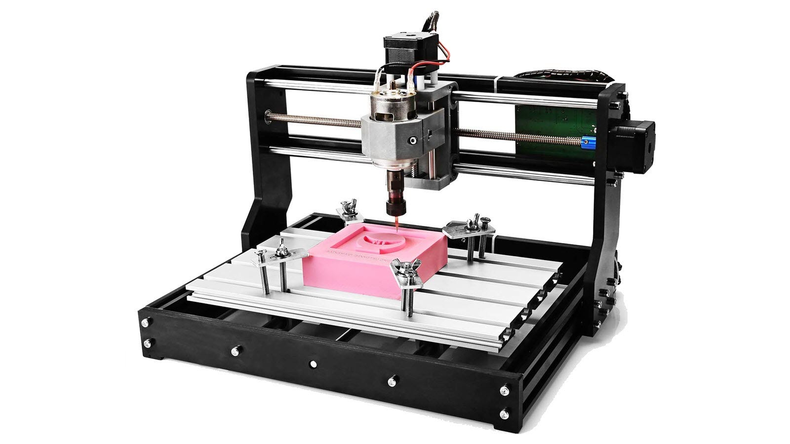 A Genmitsu CNC 3018-PRO cutting into a small pink block.