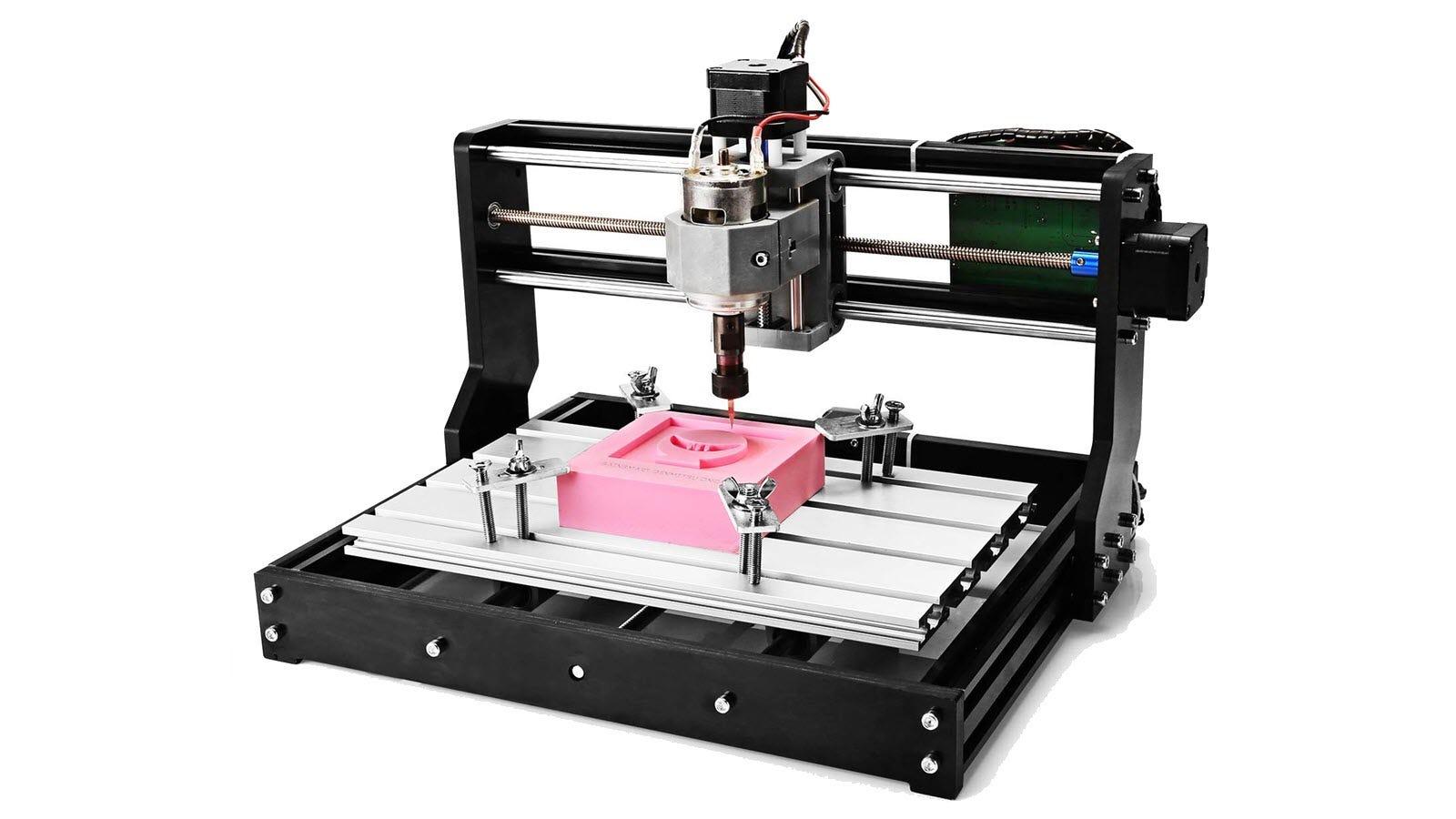 A Genmitsu CNC 3018-PRO cutting a shape into pink foam.
