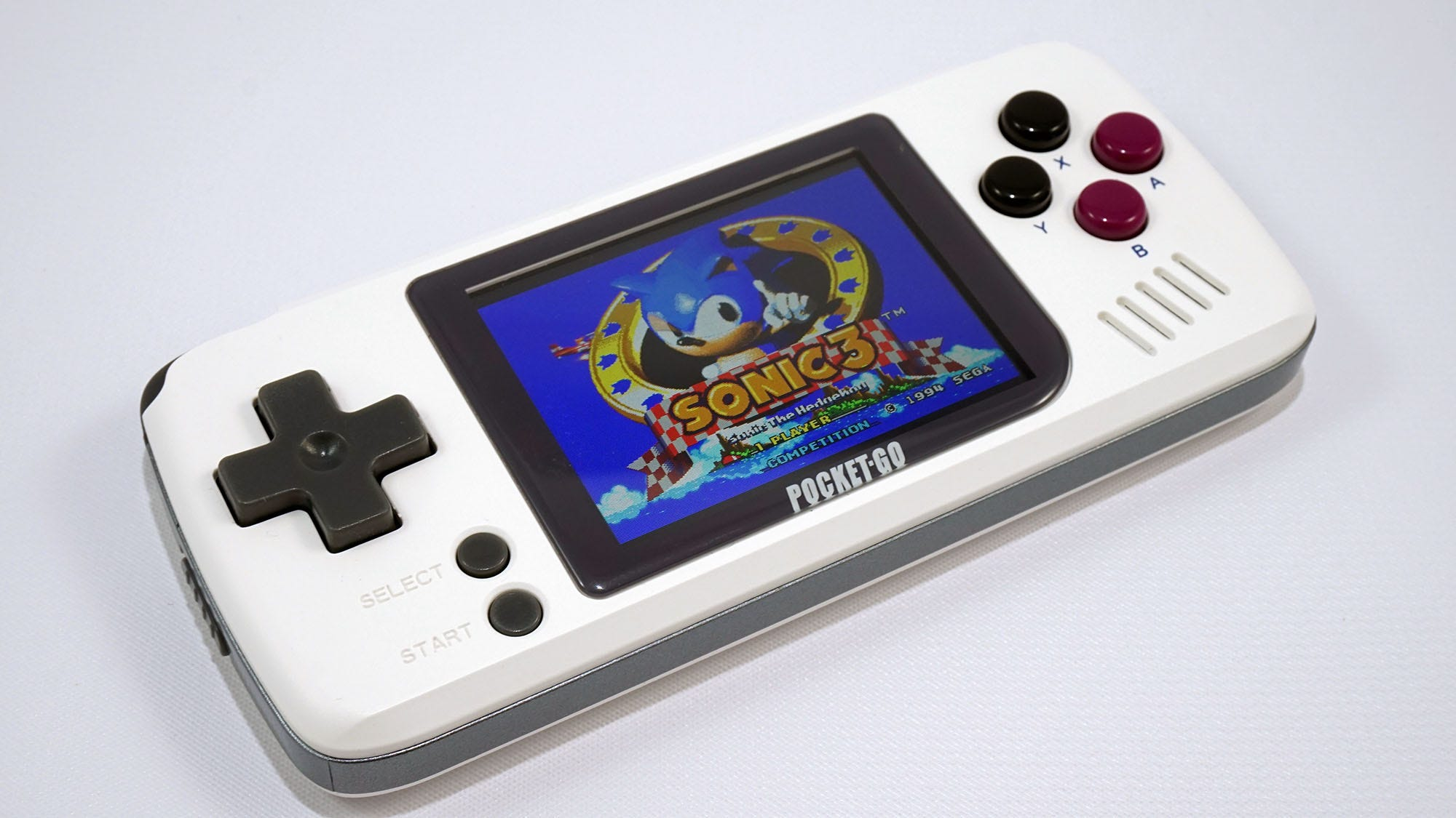 The PocketGo portable console with Sonic 3 on its screen.