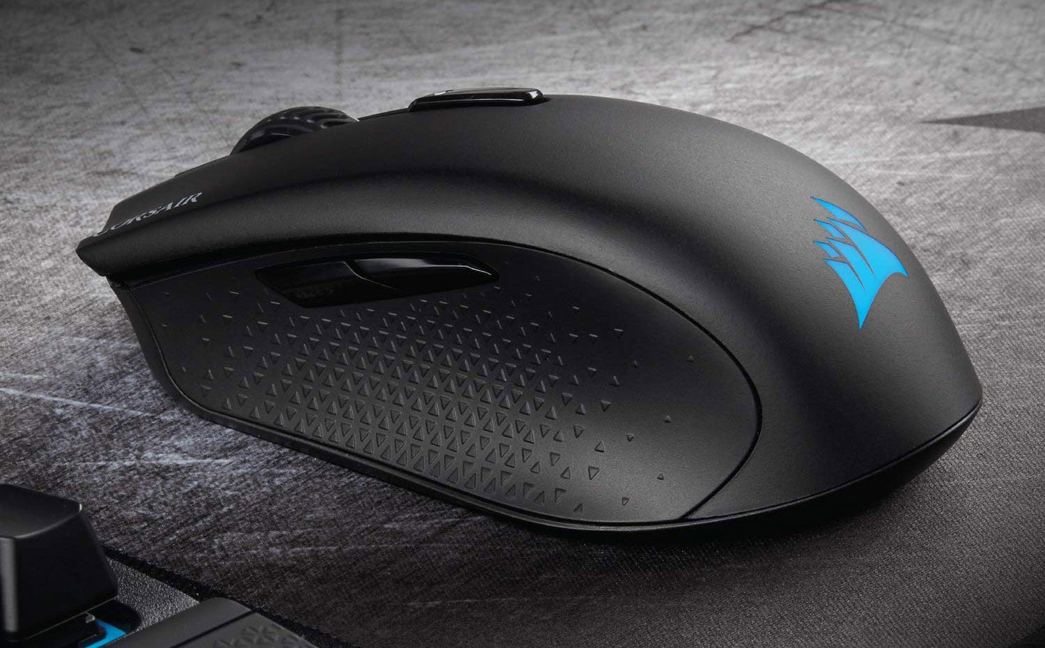 The Corsair Harpoon Wireless gaming mouse on a pad.