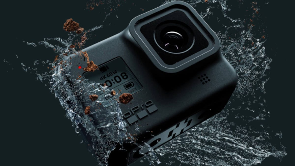A GoPro Hero 8 black, splashed in water.