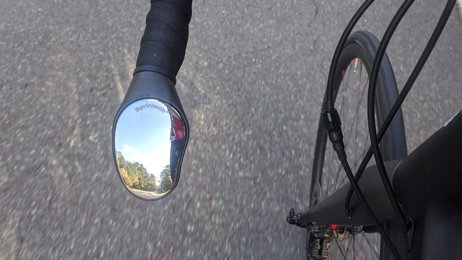 A bicycle mirror attached to a bike.