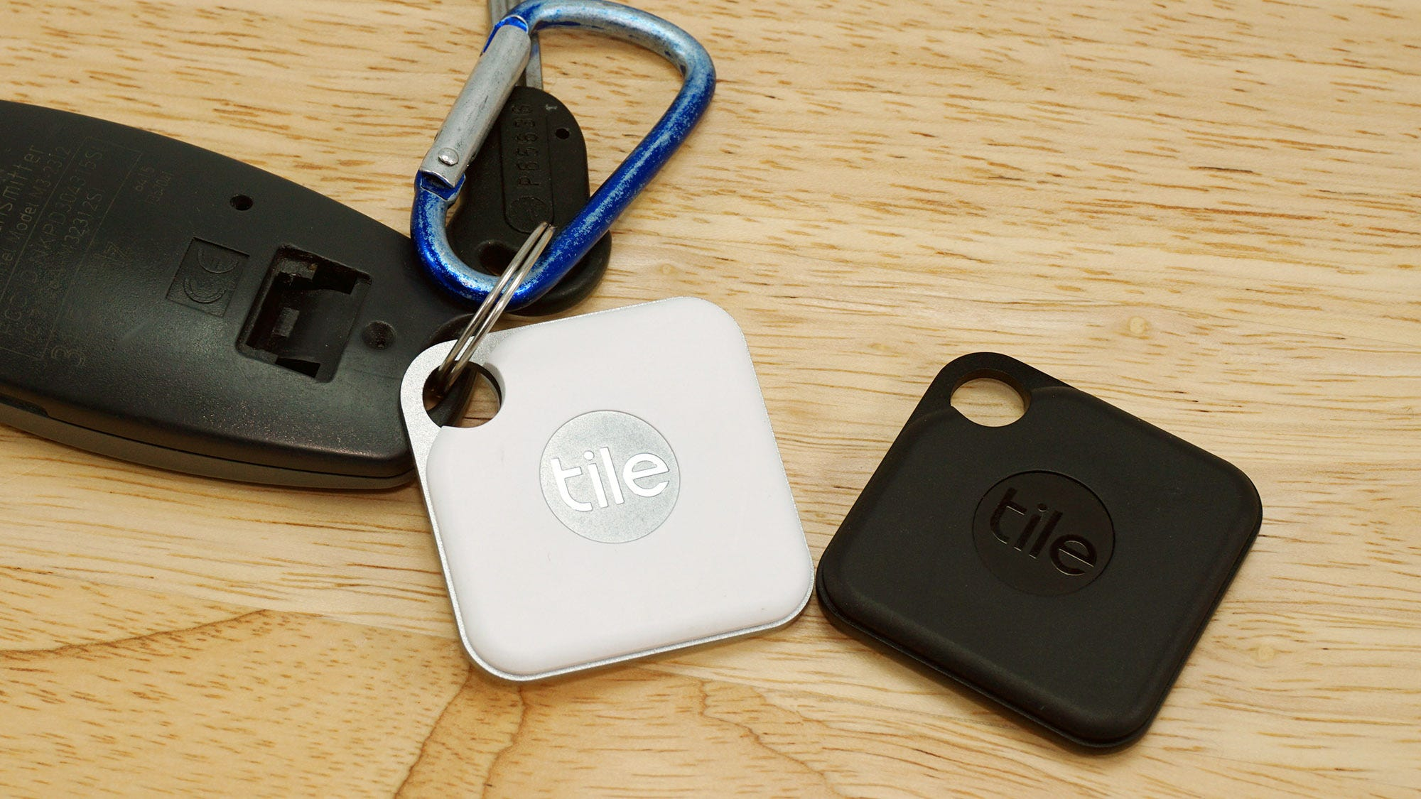 The Tile Pro in white and black, with garage keys.