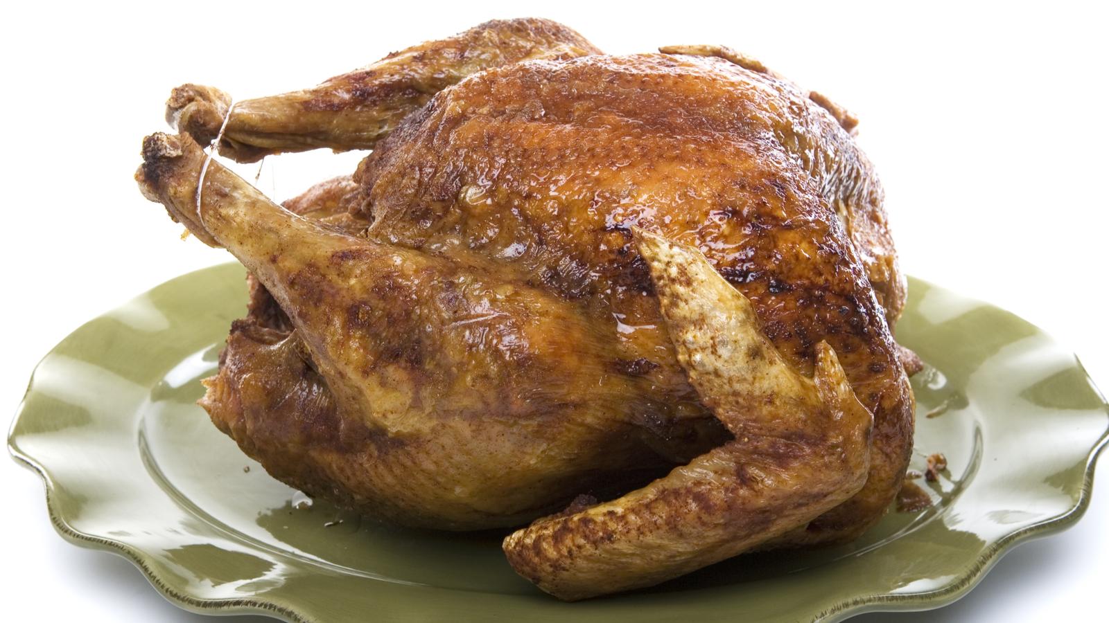 A deep fried turkey on a serving platter.