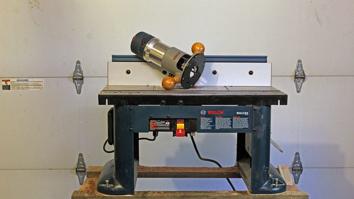A Bosch Router table and router mounted on a wooden base.