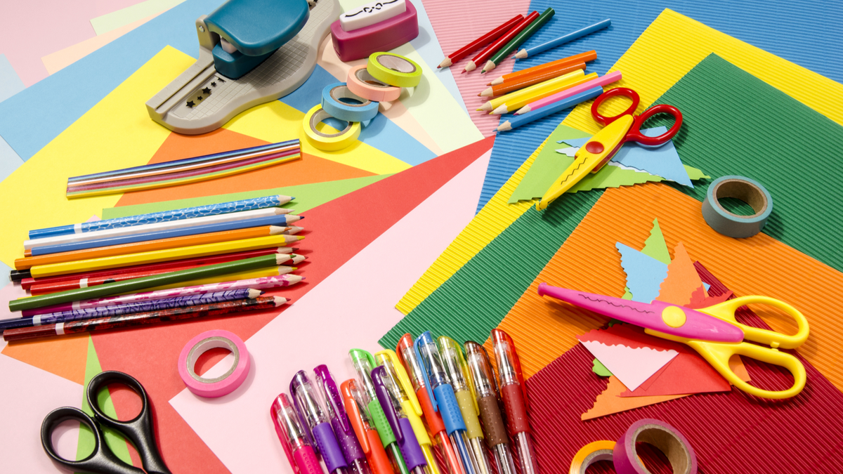 Crafting supplies on a stack of construction paper