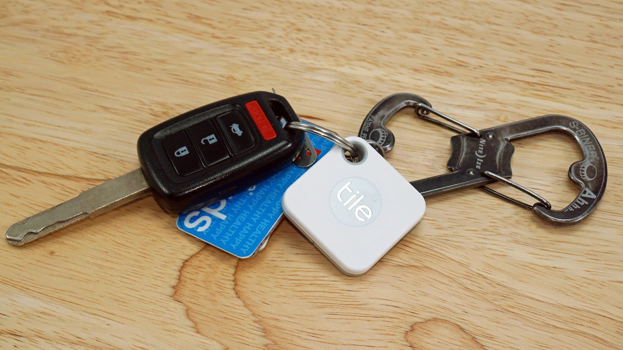 Car keys with a caribiner and Tile Mate tracker.