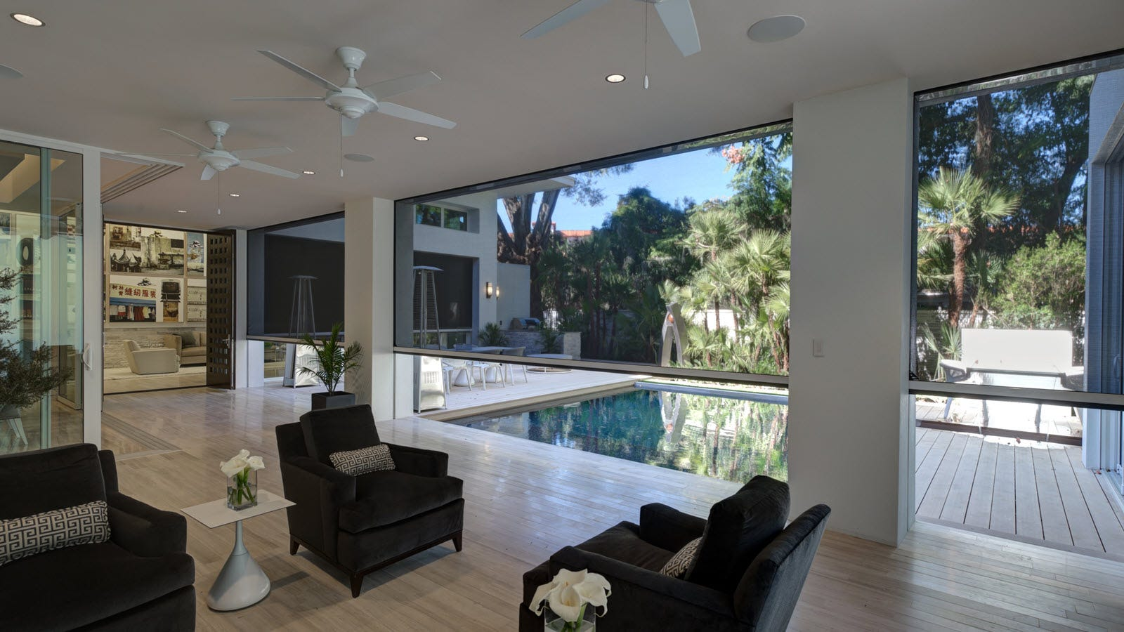 A section of home with retractable porch shades covering where walls would normally be.