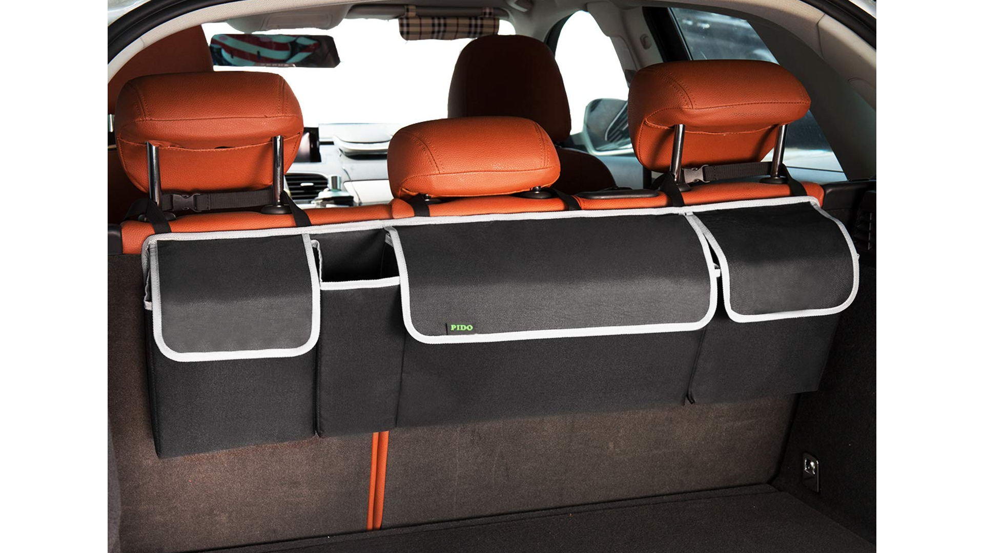The PIDO hanging organizer strapped to the back of an SUV bench.