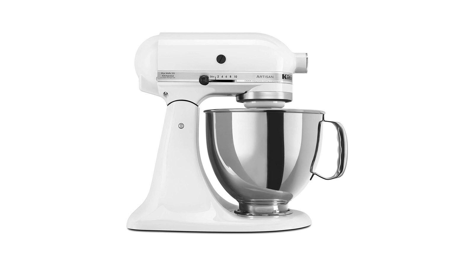 A white KitchenAid mixer with silver bowl.