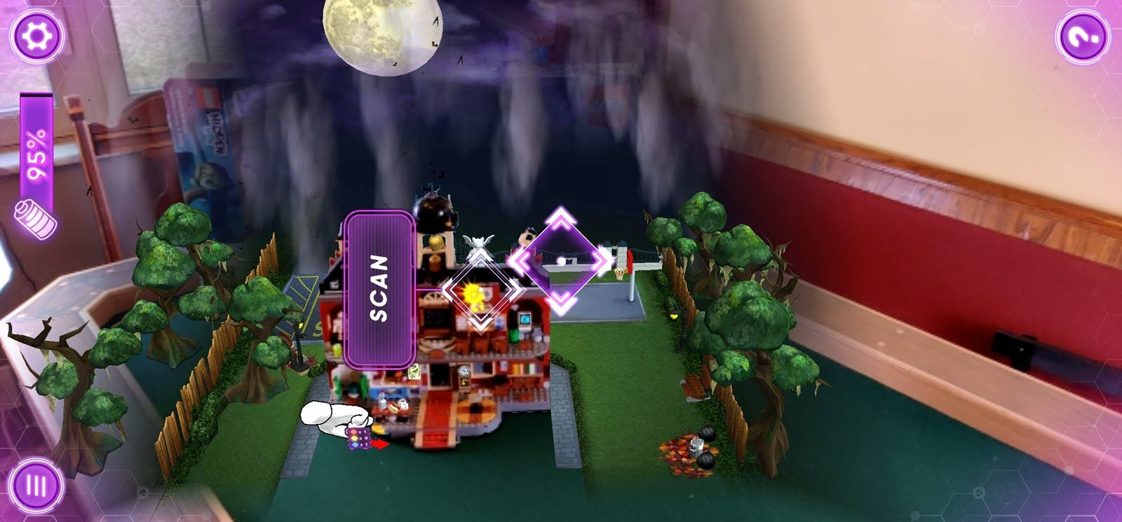 An augmented reality view of a haunted school on a game table.