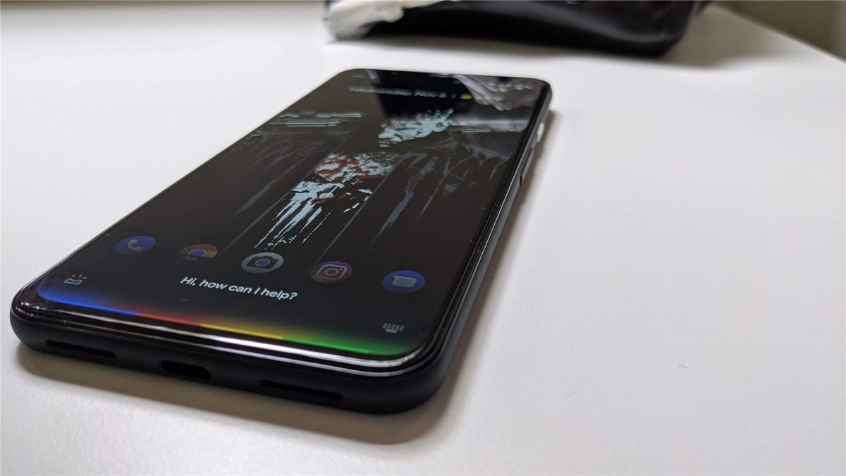 A Pixel 4 showing the updated minimalist Google Assistant UI.