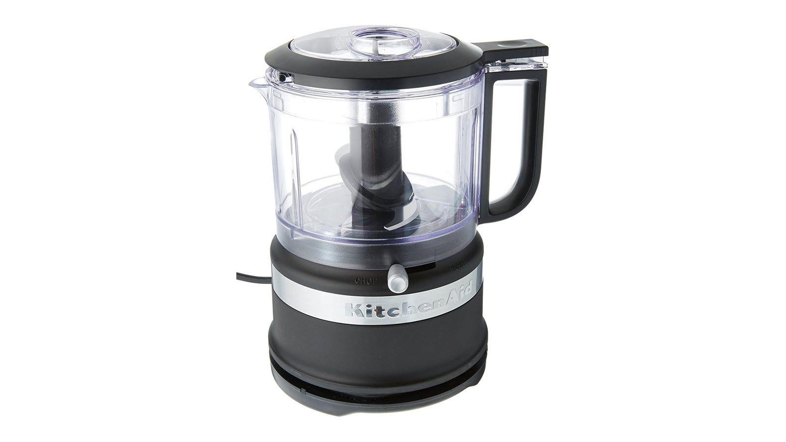 A small black KitchenAid food chopper with pour spot.