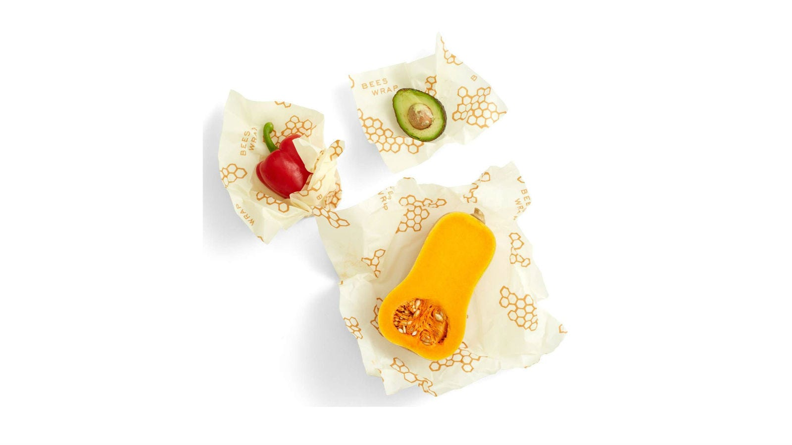Three pieces of produce each sitting on top of a piece of Bee's Wrap.