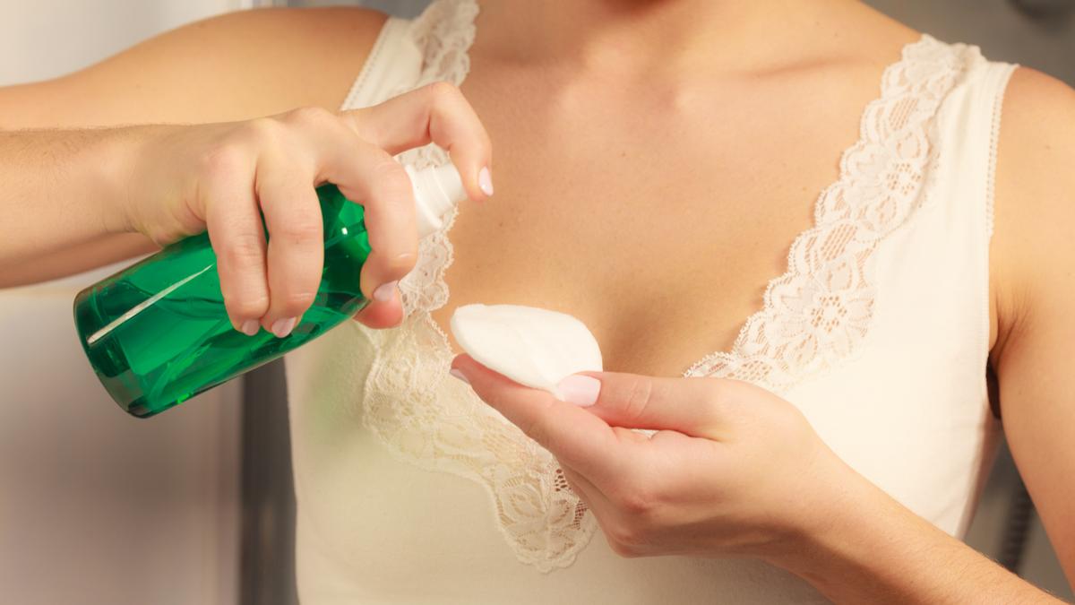 A woman using a foam makeup remover