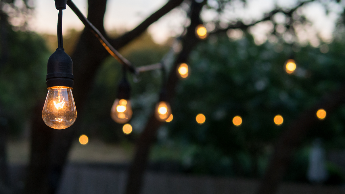 A set of string lights hanging over a patio.