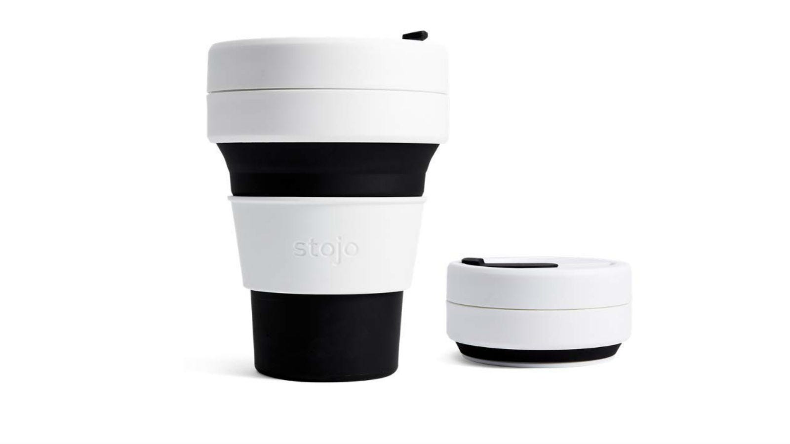 One Stojo On the Go Coffee Cup standing at full size next to one that it is collapsed.