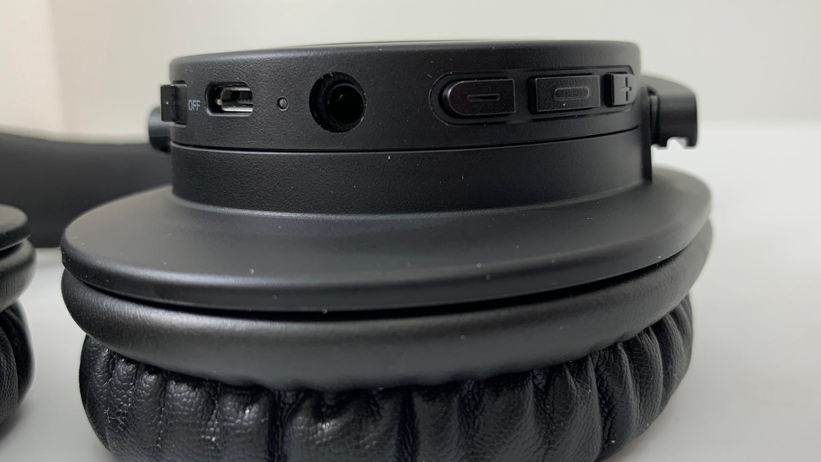 Image of controls on bottom of left earcup