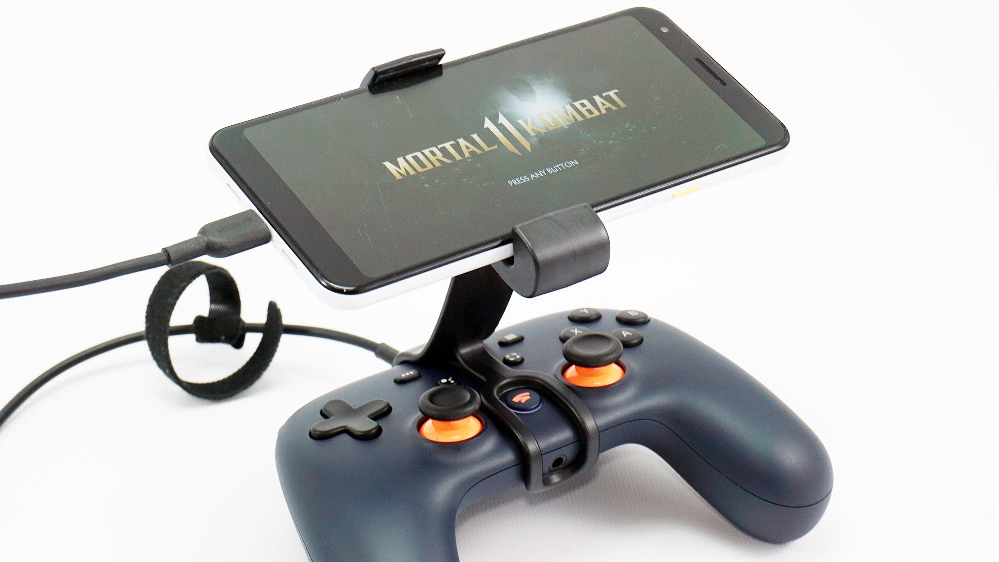 A Stadia controller, phone, and mount.