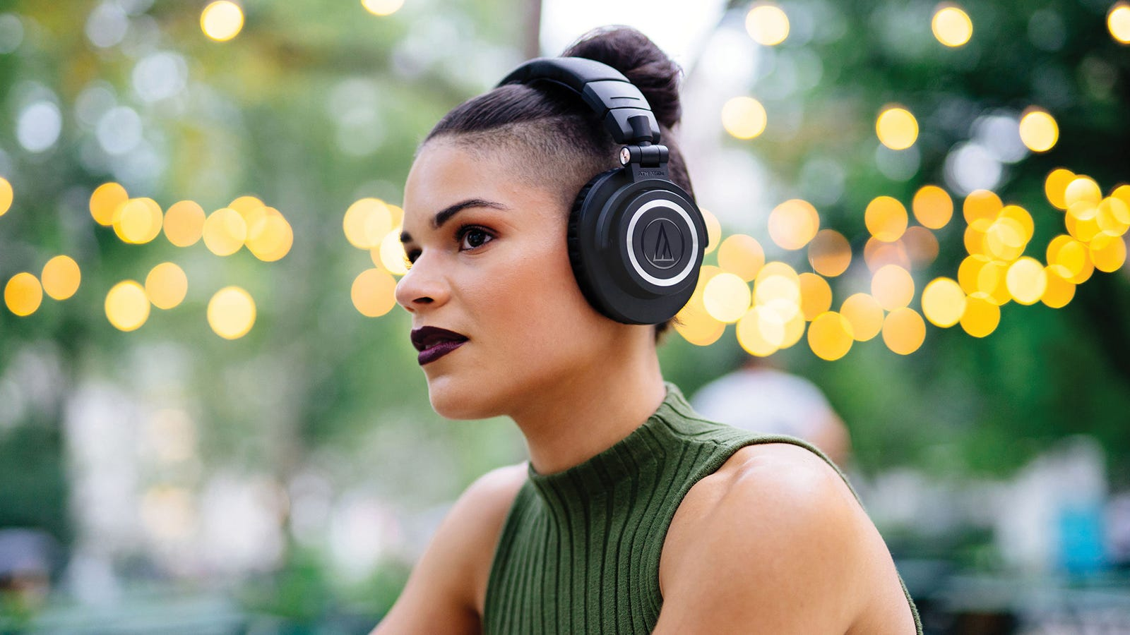 Image of a woman wearing headphones