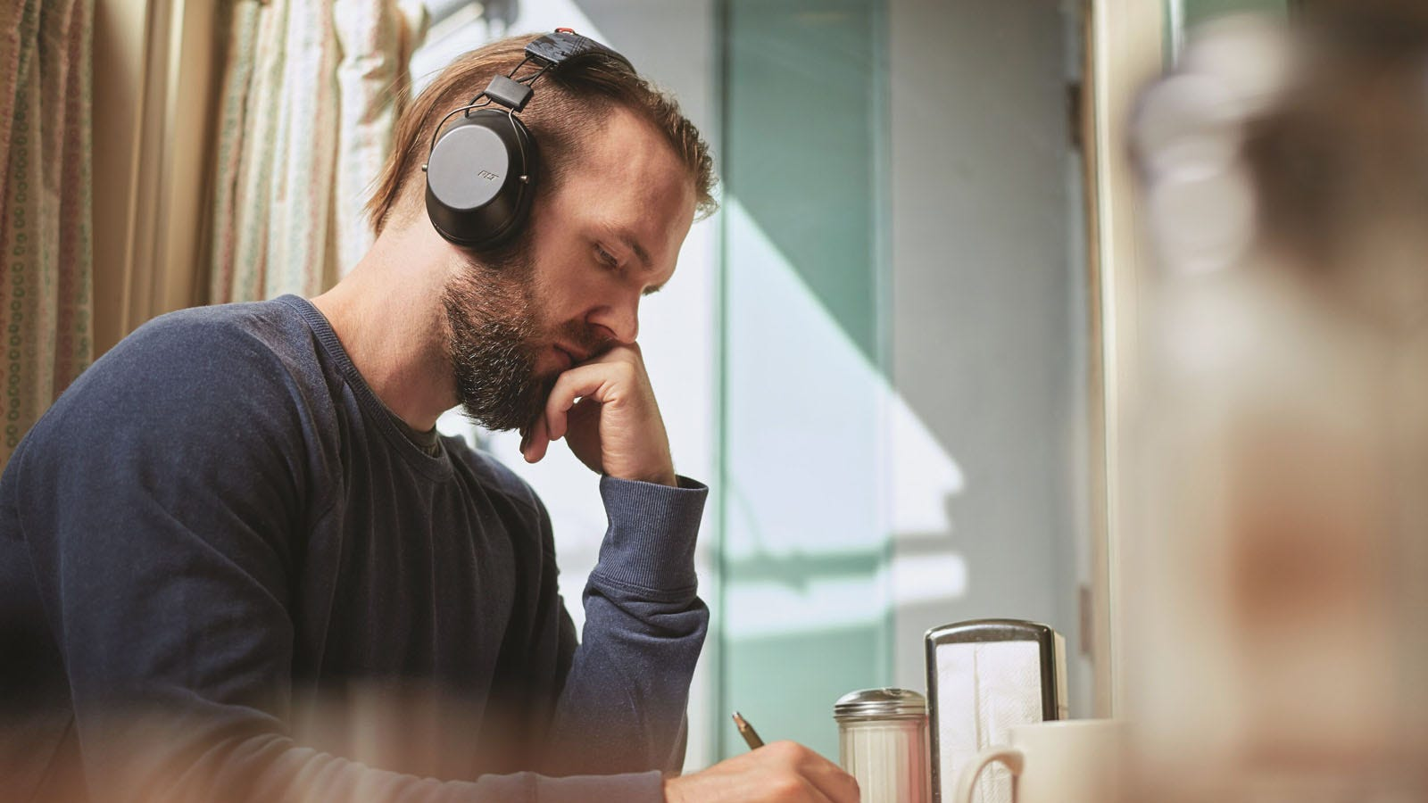 Image of a man wearing headphones