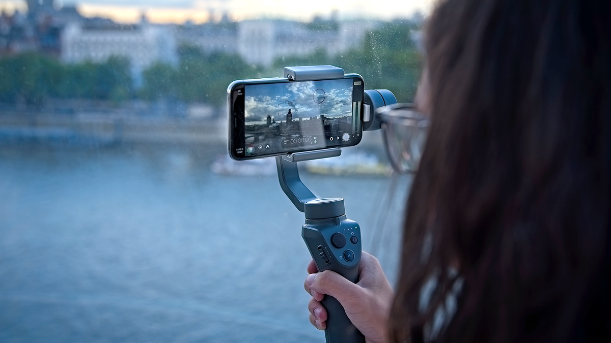 A person using the DJI OSMO phone gimbal.
