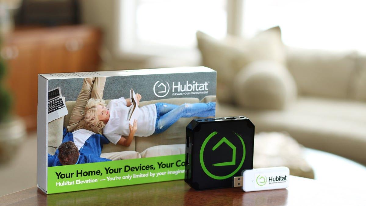 A Hubitat Hub, USB stick, and Box in a living room.