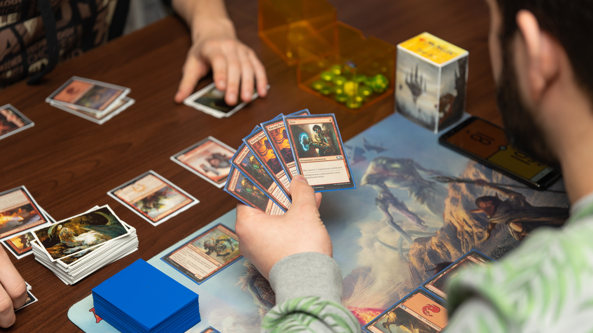 A couple of guys playing Magic: The Gathering