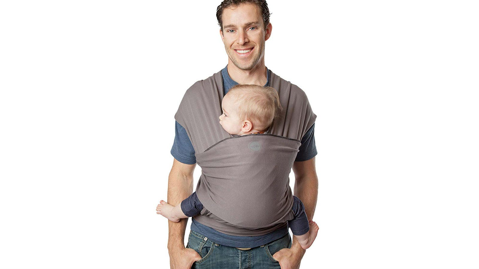 A man carrying a baby in a Moby Classic Baby Wrap.