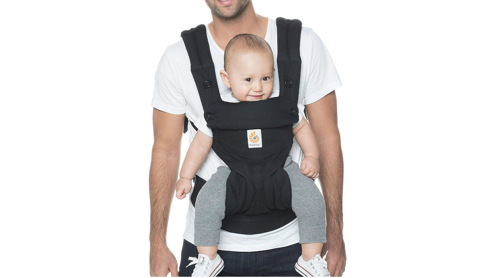 A man wearing a baby in an Ergobaby 360 Carrier.