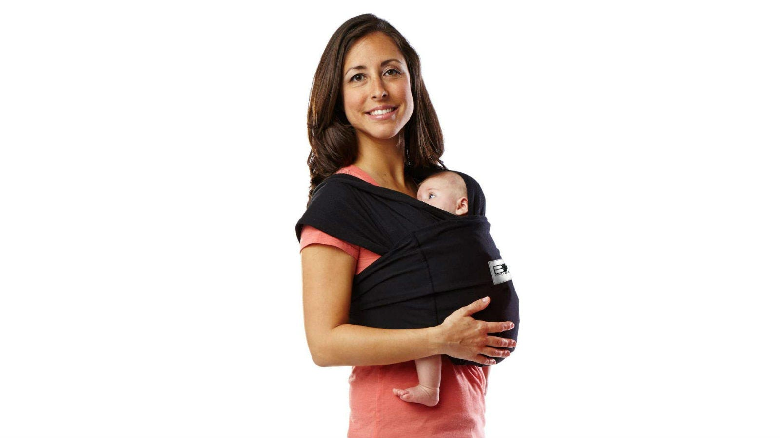 A woman holding a baby in a Baby K'Tan Original Carrier.