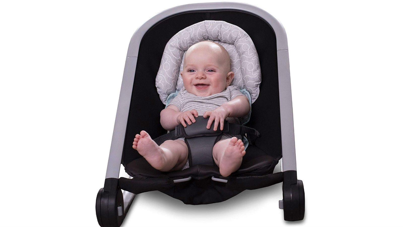 A baby in a detached stroller seat resting his head on the Boppy Noggin Nest Head Support.
