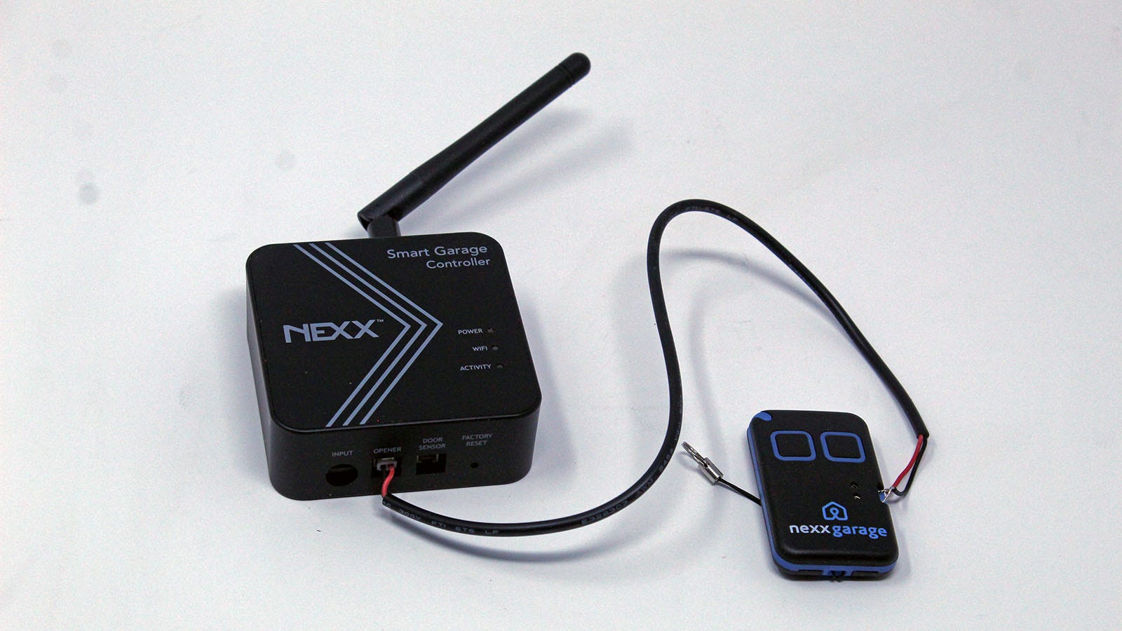 The Nexx Smart Garage Controller wired to the Nexx garage smart adapter.