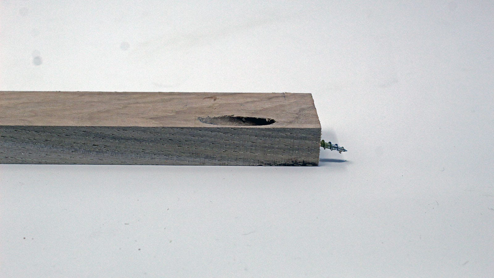 A long board with a pocket hole and a screw driven through the end.