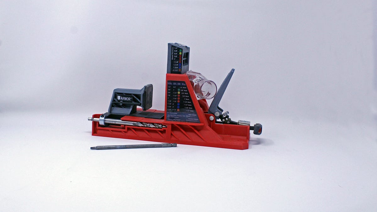 A red Armor branded pocket hole jig.