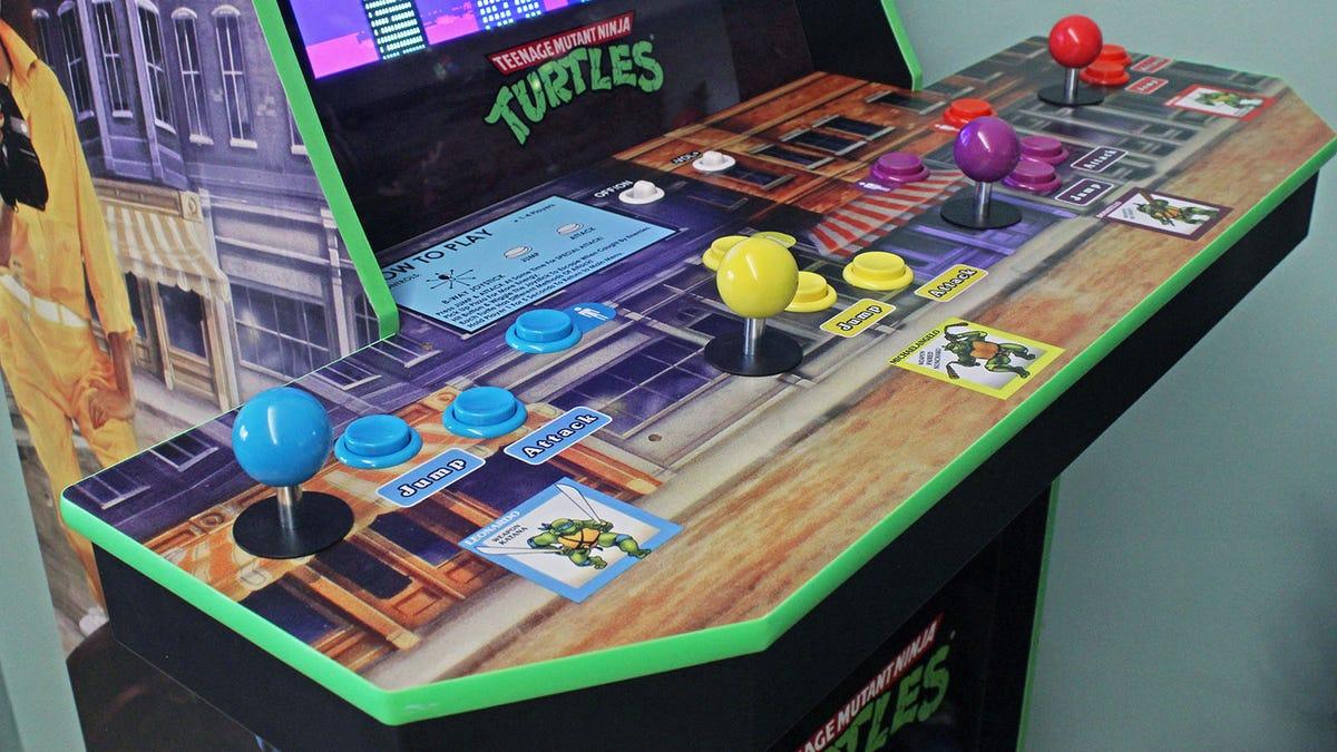 The Teenage Mutant Ninja Turtle Arcade control deck and the logo on the screen.