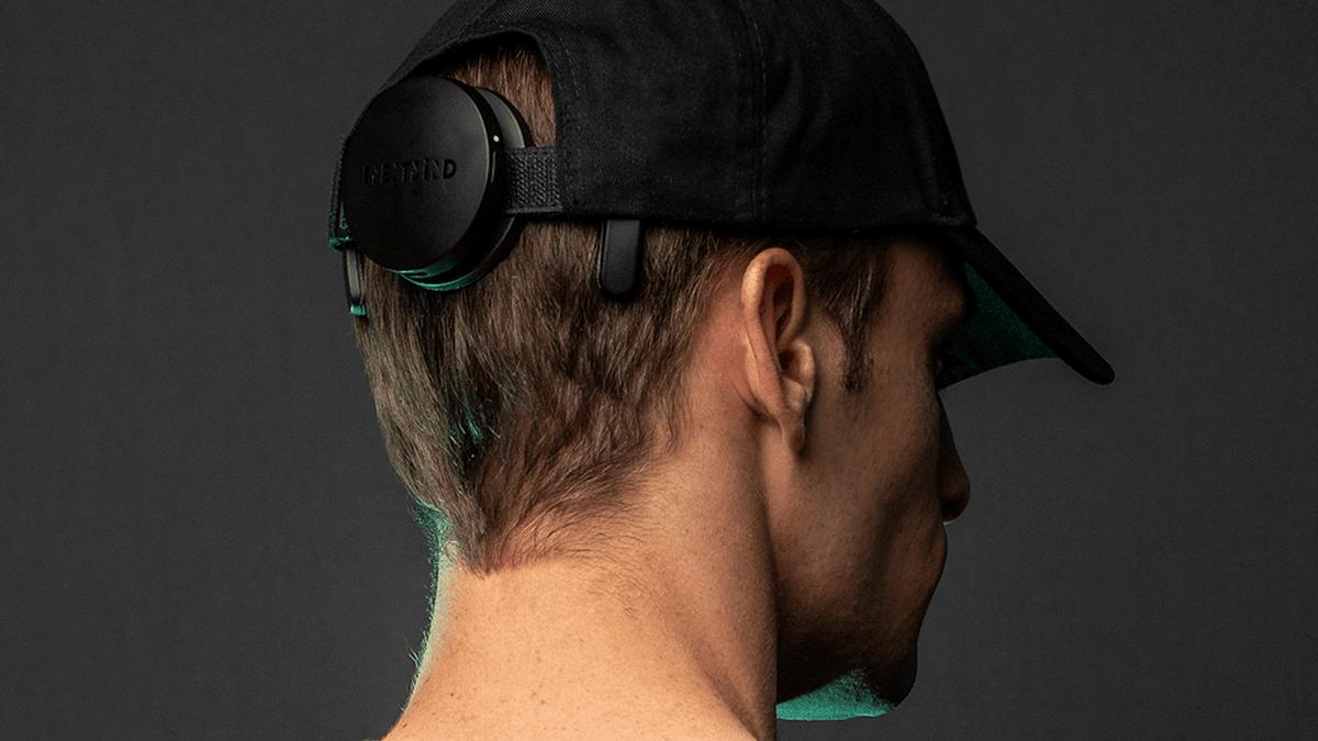 NextMind device on the back of a baseball cap.