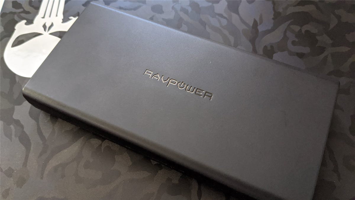 The RavPower battery on a Pixelbook with a camo skin and Punisher sticker