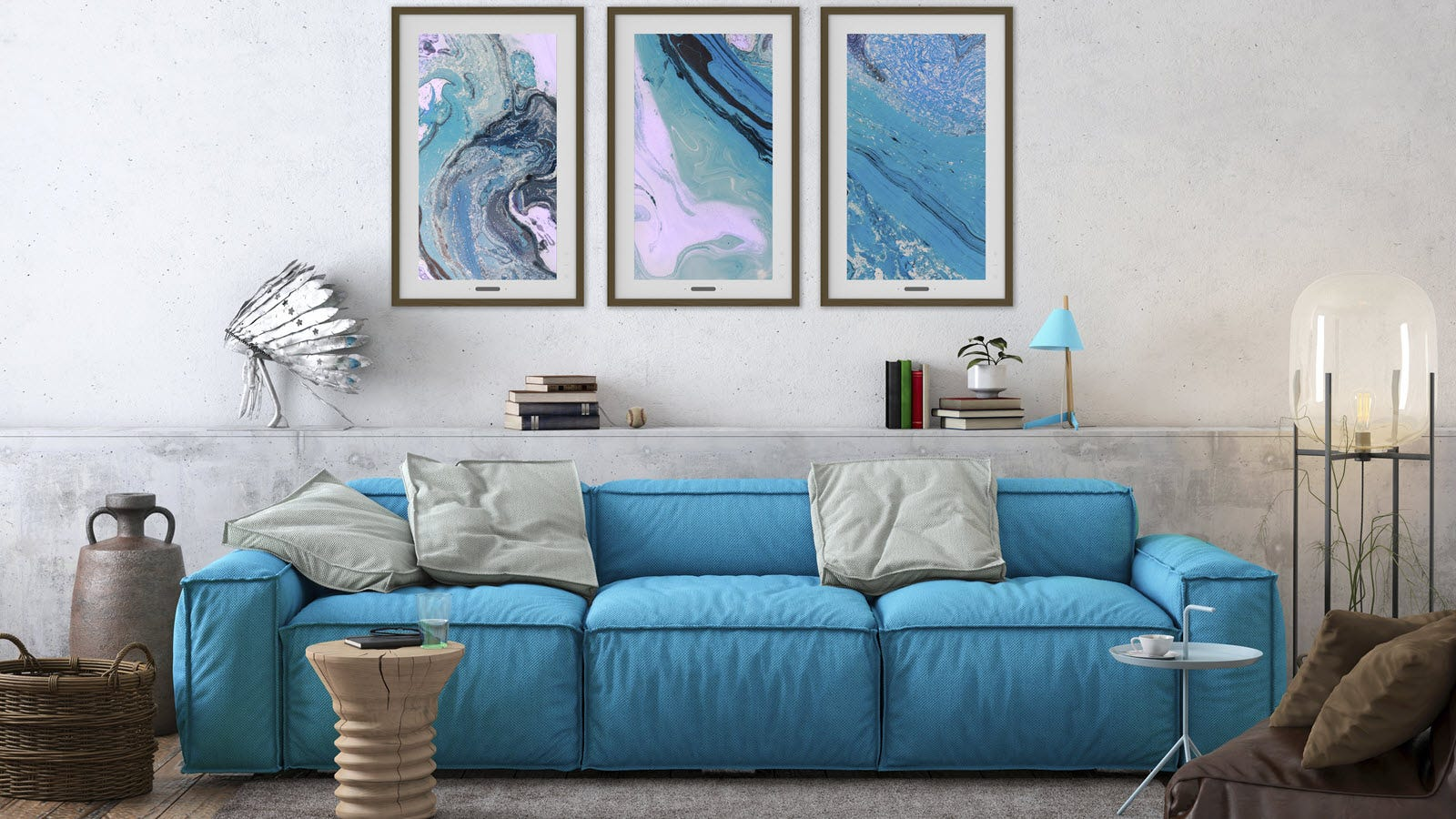 Three Lenovo Smart frames with a shared ocean view over a blue couch.