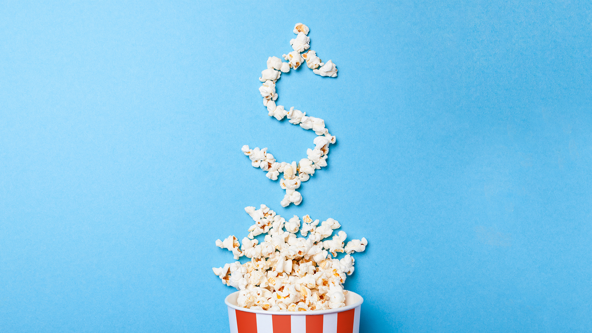 A tub of popcorn spills over, the popcorn turns into a dollar sign.