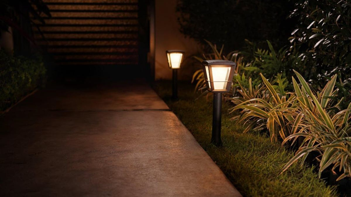 A driveway lined by two pedestal smart lights.