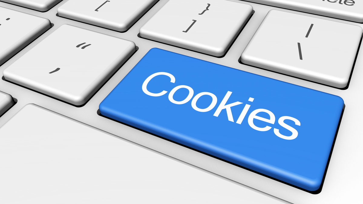 """A keyboard, with the enter key replaced by a blue """"Cookies"""" key."""