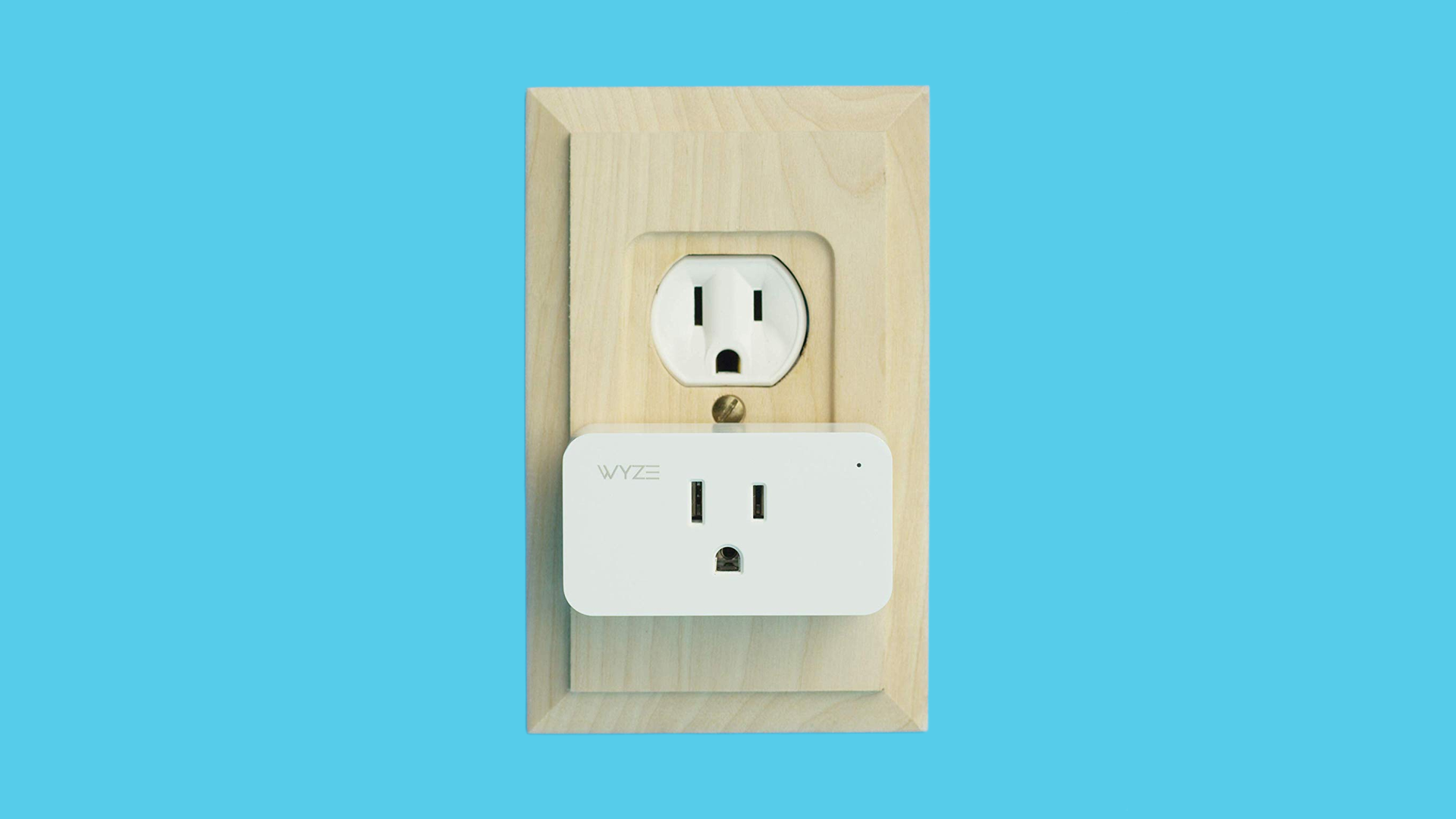 A Wyze smart plug in a socket with a wooden coverplate.