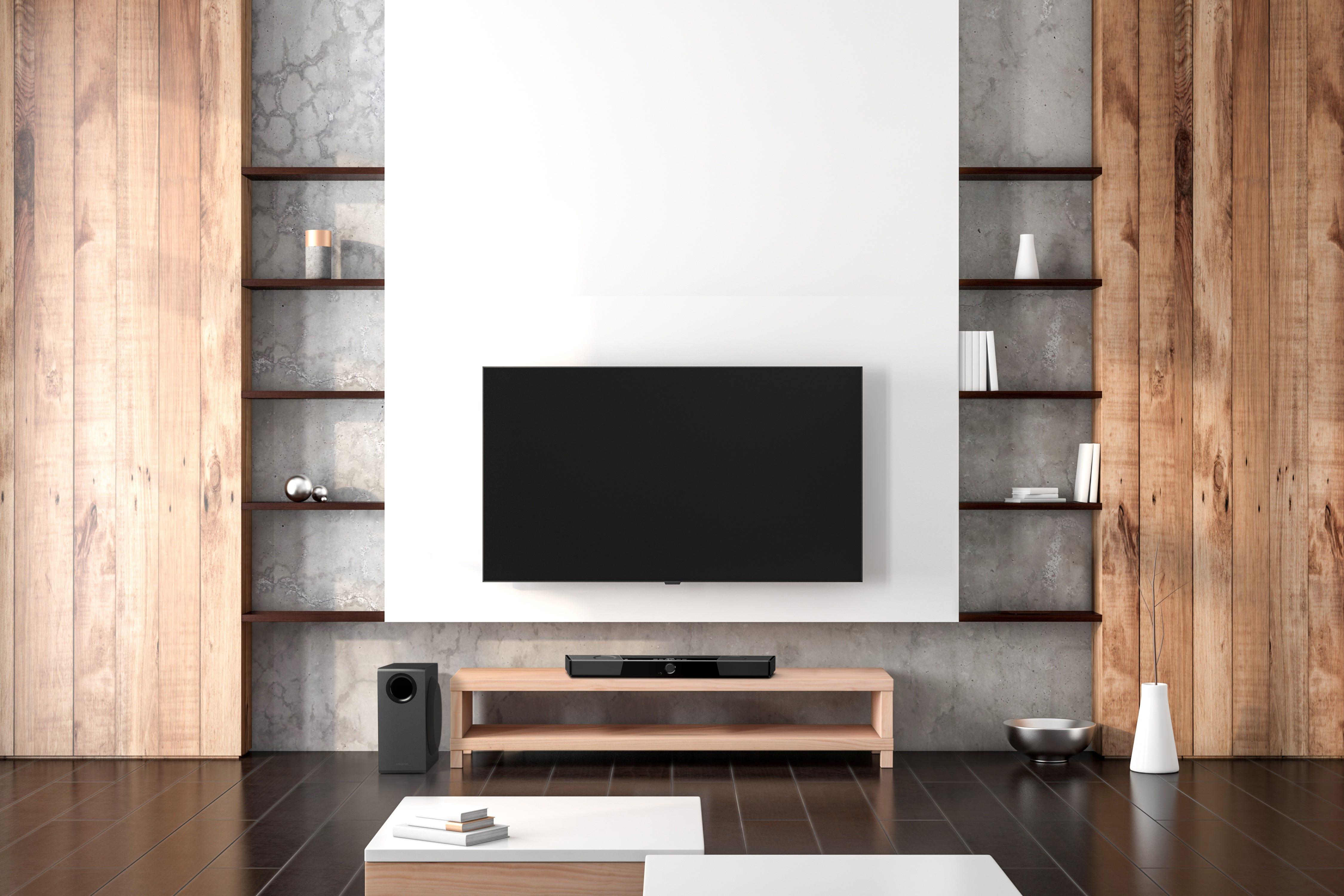 Creative Super X-Fi Carrier soundbar beneath a TV in a modern room setting