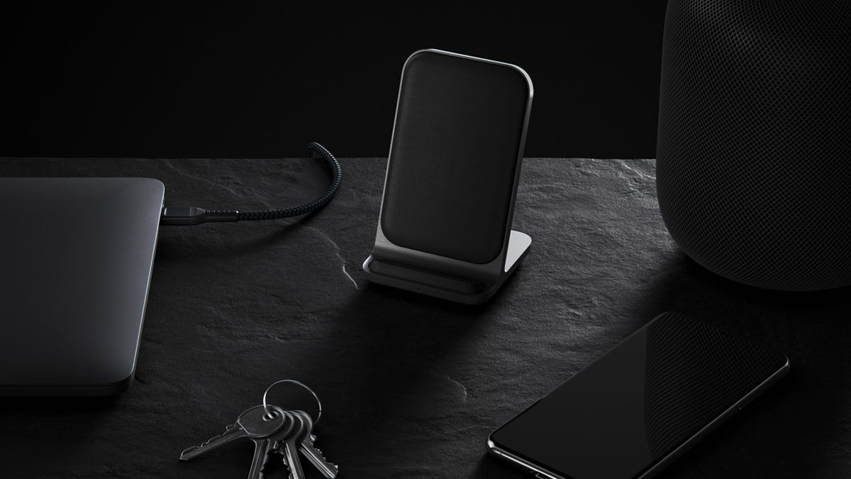 Nomad Base Station Stand wireless charger on a table