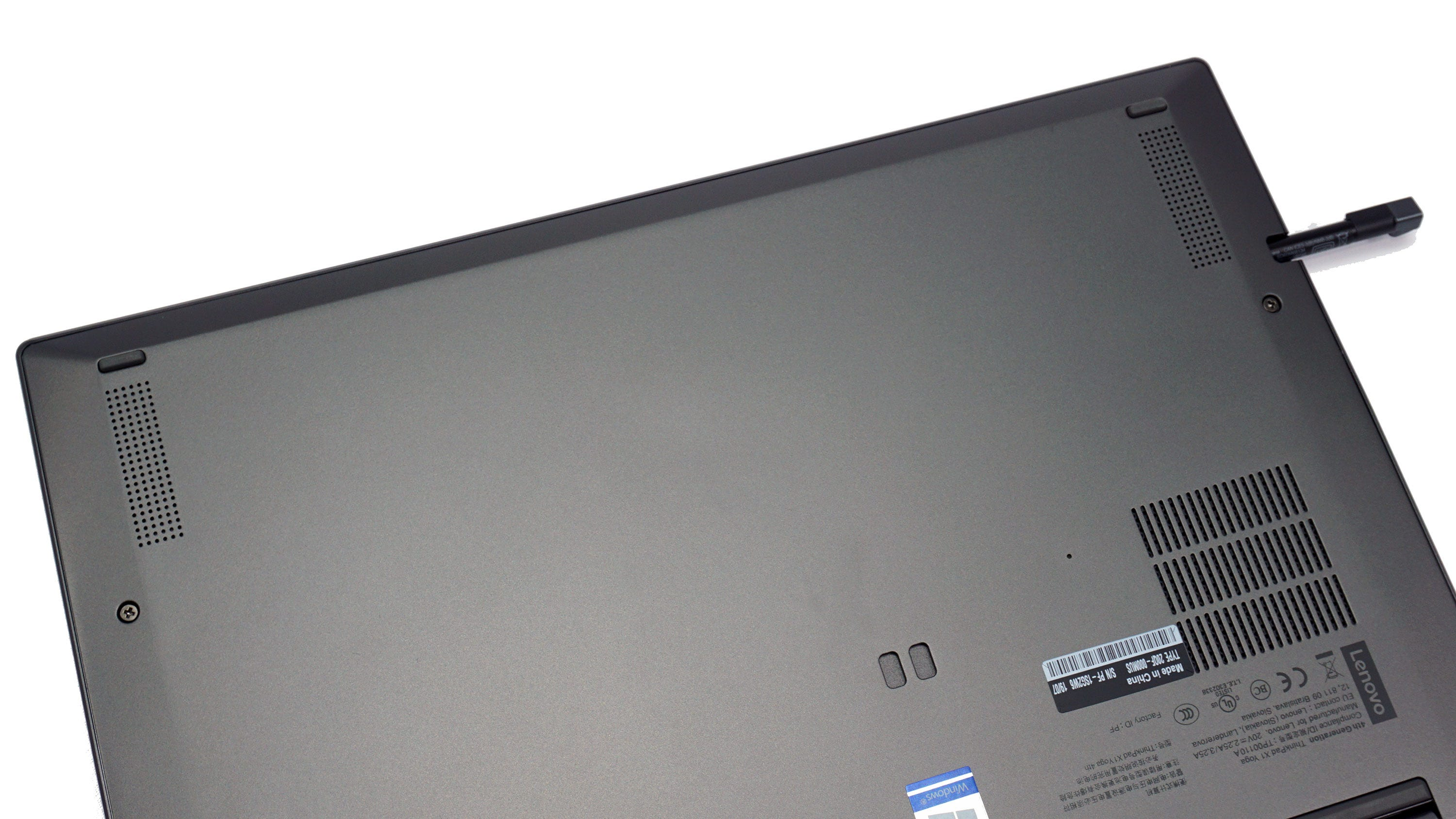 The small speaker grilles on the bottom of the X1 Yoga laptop.