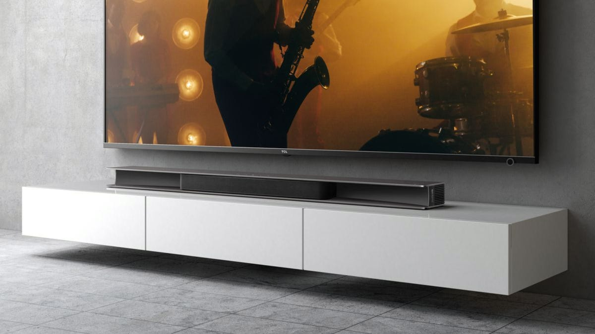 TCL Alto 9 Plus soundbar underneath a TV in the living room